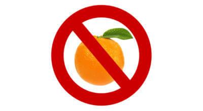 zdjęcie pomarańczy z nałożonym czerwonym przekreśleniem